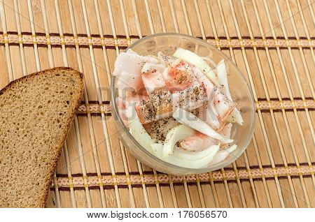 chopped lard with onions in a plate and bread