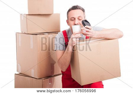 Mover Guy Holding Box And Smelling Fresh Coffee