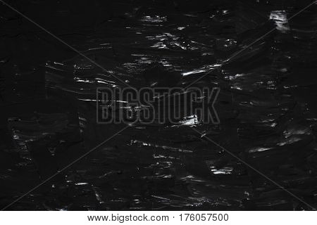 Black decorative background. Texture putty and concrete.