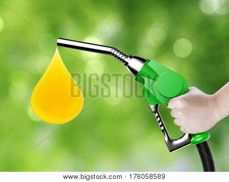 Hand Holding Gas Pump Nozzle With Oil Drop