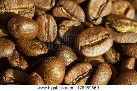 Roasted coffee beans background concept extreme close up macro