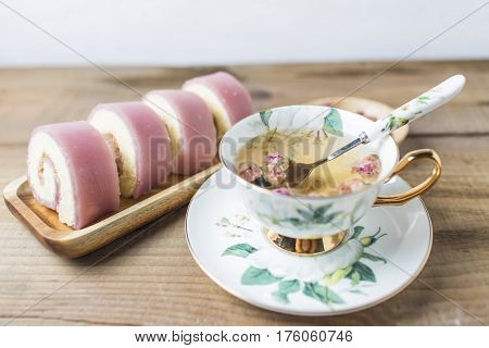 Home French rolls with a cup of tea