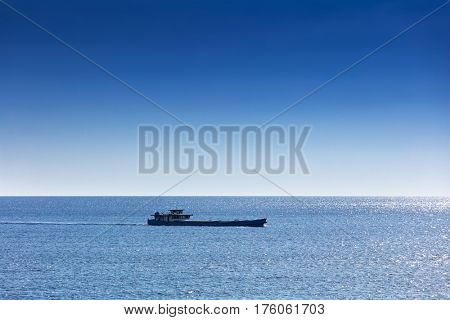 large cargo boat transporting in the ocean