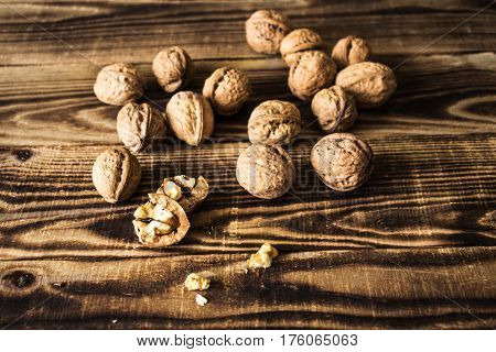 a walnuts on wooden background and texture