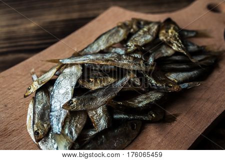a little smoked sprats on wooden background
