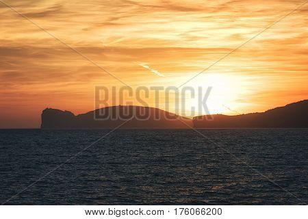 Sunsets over Cliffs of Capo Caccia Peninsula near Alghero City, Province of Sassari, Sardina, Italy