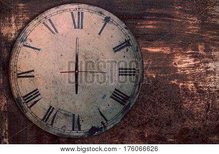 Antique clock on the old iron and rusty.