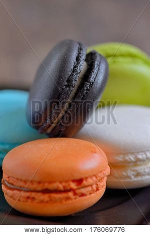 french colorful macarons on wooden table