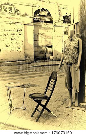 Female shop dummy fashion mannequin near the department store boutique wearing current women's fashions in clothes. City of Jaffa in Israel. Vintage Style Toned Picture