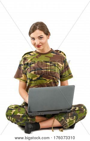 Young Woman Soldier In Camouflage Outfit With A Laptop