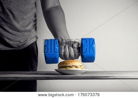Male Hand Reaching To Pick Up Dumbbell Idea Exercises For Weight Loss Diet Concept.