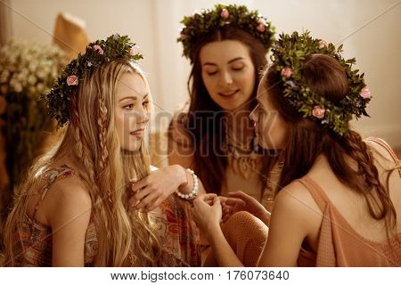 Women In Floral Wreaths