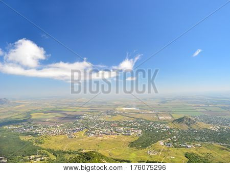 Bird's-eye view to landskape of city and forest