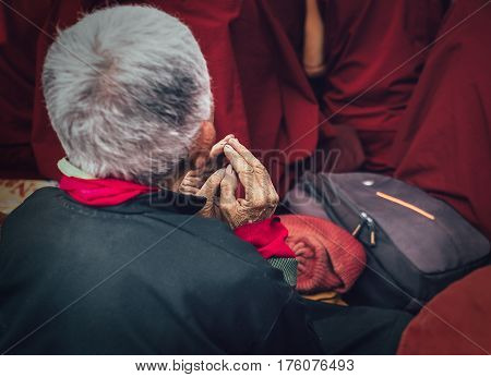 Old man buddhist monk's hands in prayer gesture