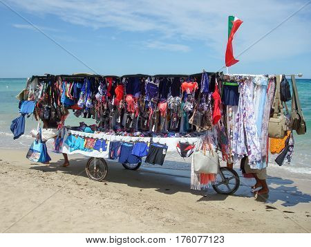 Torre Canne Italy - 20 June 2016: hawkers push their cart on the beach of Torre Canne on Puglia Italy