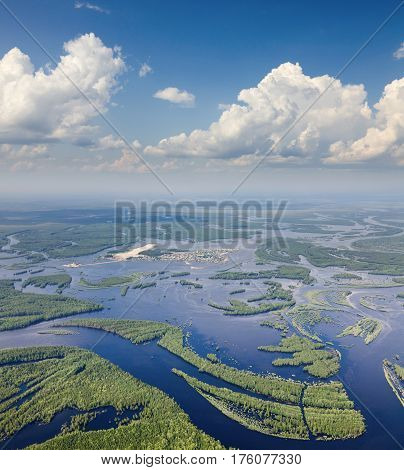 Aerial view river in flooded forest plains during summer.