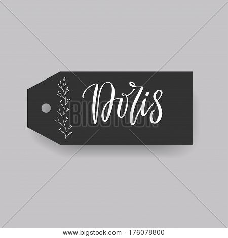 Doris - common female first name on a tag, perfect for seating card usage. One of wide collection in modern calligraphy style.