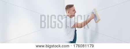 Plasterer Wearing Dungarees