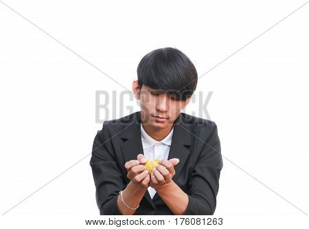 handsome man eating a fresh orange on white background