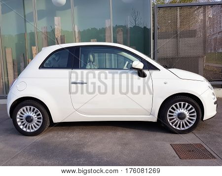 Lyon France - February 19 2017: White Fiat 500 (Side View) Parked in The Street Of Lyon France
