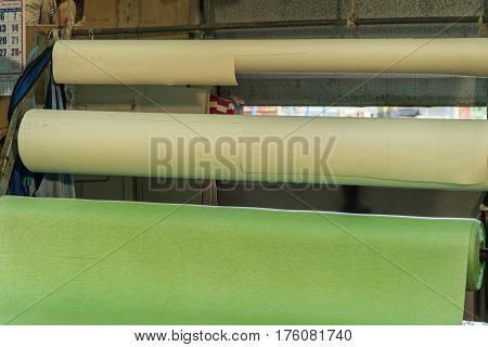 Textile factory and Colorful roll of Fabrics.