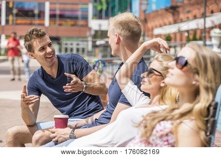 Two Couples Talking In The City Center