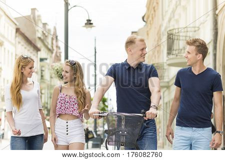 Friends Going For A Walk On A Promenade