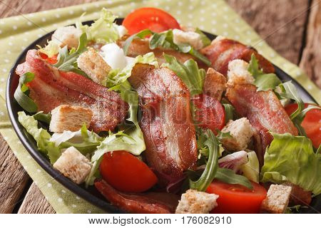 Spicy Salad Of Bacon, Tomato, Croutons And Lettuce Close-up On A Plate. Horizontal