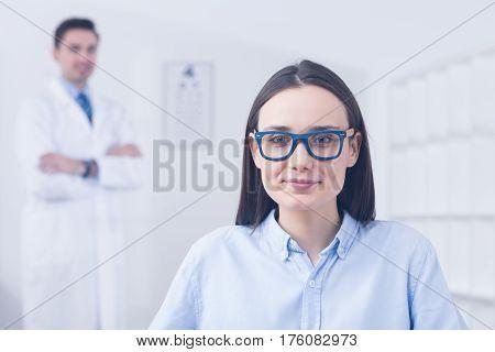 Woman At Optician Store