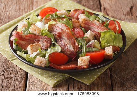 Mix Salad Of Fried Bacon, Tomato, Croutons And Lettuce Close-up. Horizontal
