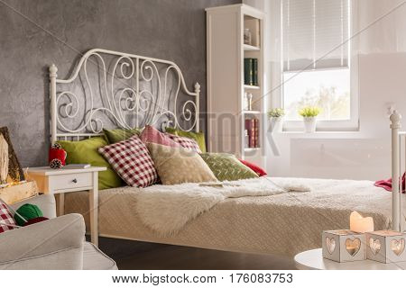Picture of bright bedroom interior with marital bed