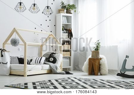 Bedroom With Wooden House Bed