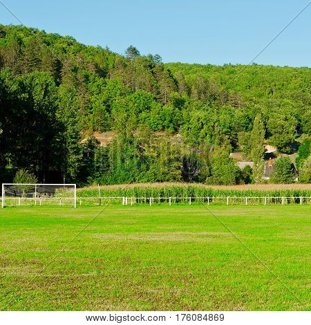 Football Field on the Background of Village in France