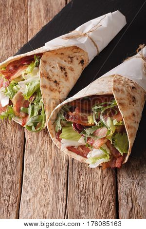 Bacon And Lettuce Wrapped In Pita Bread Close-up. Vertical