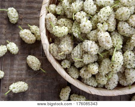 White Mulberry In A Basket On A Wooden Background