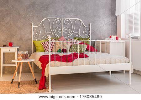 Cozy marital bed in modern bedroom, horizontal