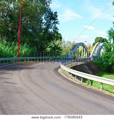 Winding Asphalt Road and bridge  in France