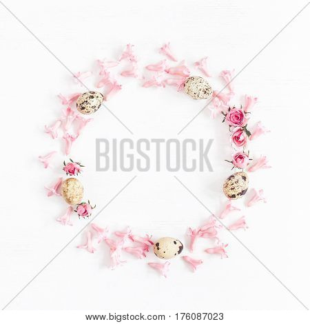 Easter wreath made of quail eggs and flowers. Easter frame. Flat lay top view