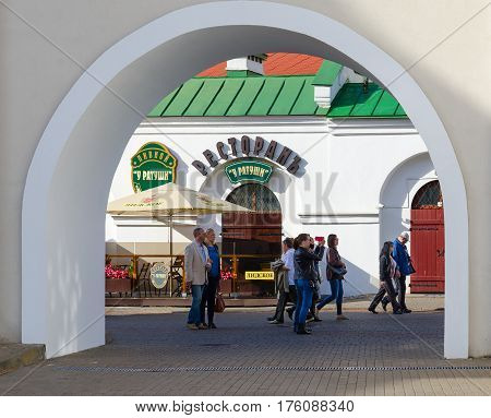 MINSK BELARUS - OCTOBER 1 2016: Unknown people walk along street near beer restaurant