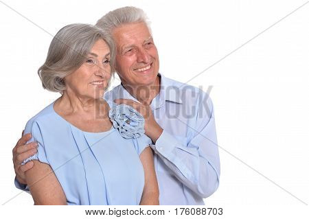 Portrait of a happy old couple embracing on a white background