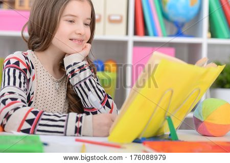 Portrait of a cute girl does lessons