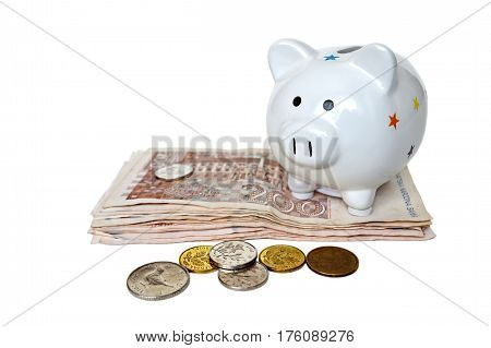 Piggy bank and Croatian banknotes isolated on white background