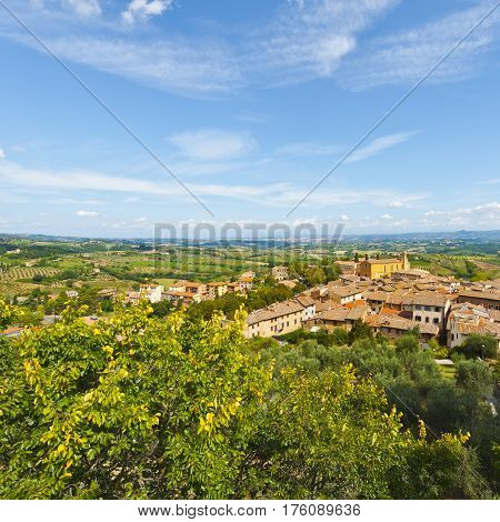 Aerial View of the Medieval City of Gimignano and Surrounding Tuscan Landscape in Italy