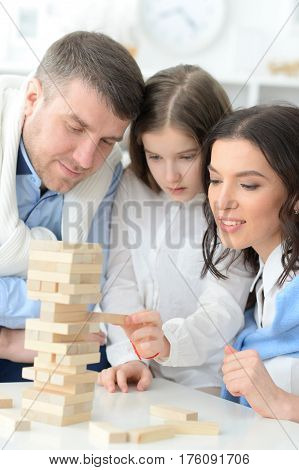 Portrait of a family with daughter playing a game