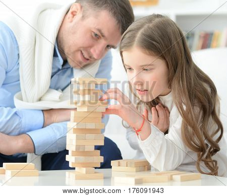 Portrait of a father and daughter playing a game