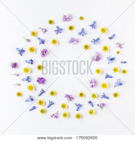 Flowers composition. Wreath made of various colorful flowers on white background. Flat lay top view