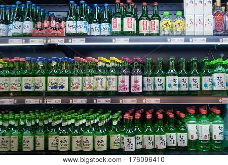SEOUL KOREA - MARCH 13 2017: Soju bottles of various flavors displayed in the supermarket in South Korea.