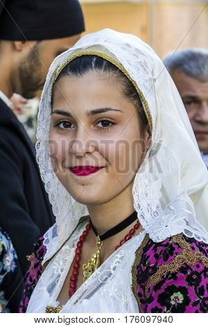 QUARTU S.E., ITALY - September 17, 2016: Parade of Sardinian costumes and floats for the grape festival in honor of the celebration of St. Helena. Portrait of a beautiful girl in traditional Sardinian costume - Sardinia