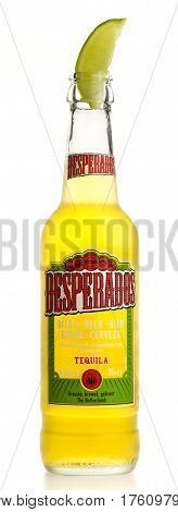 GRONINGEN, NETHERLANDS - MARCH 04, 2017: Bottle of Mexican Desperados Tequila beer with lime wedge isolated on a white background