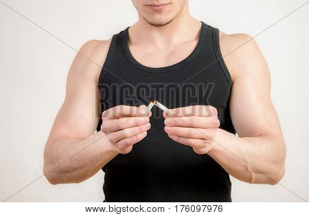 Quit smoking - Young man crushing cigarette